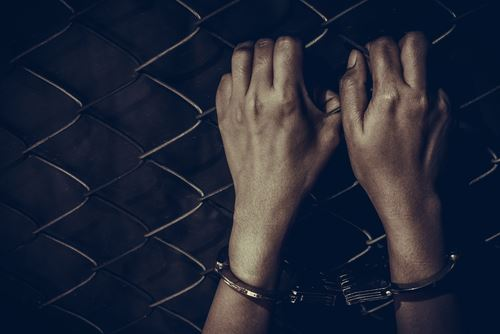 Handcuffs and a chain fence